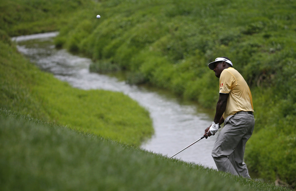 Photo - Vijay Singh, of Fiji, hits a chip on the second hole during the third round of the PGA Championship golf tournament at Valhalla Golf Club on Saturday, Aug. 9, 2014, in Louisville, Ky. (AP Photo/Mike Groll)