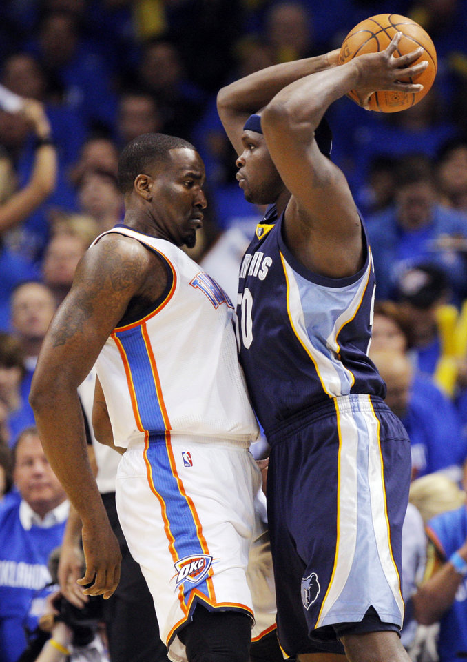 Photo - Oklahoma City's Kendrick Perkins (5), left, defends Zach Randolph (50) of Memphis in the first half during game one of the Western Conference semifinals between the Memphis Grizzlies and the Oklahoma City Thunder in the NBA basketball playoffs at Oklahoma City Arena in Oklahoma City, Sunday, May 1, 2011. Photo by Nate Billings, The Oklahoman