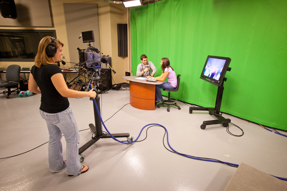 Photo - In this 2012 photo provided by Adrian College, students use television equipment in Rush Hall which was renovated into a multimedia facility with digital television and radio studios, multiple control rooms, a lab room with computers used for editing, sound stage and classroom space, at the school in Adrian, Mich. For today's increasingly career-focused students, a liberal arts education is a tough sell. So, many small liberal arts colleges such as Adrian are shifting toward a pre-professional curriculum. (AP Photo/Adrian College, Matt Gaidica Photography)