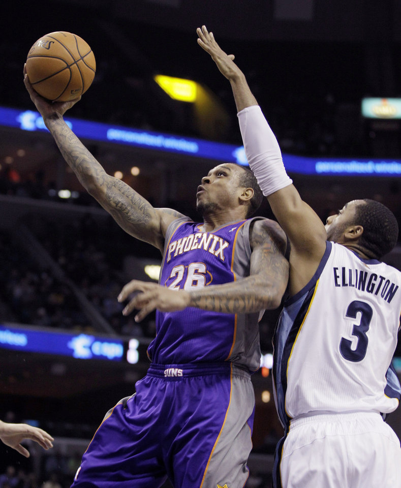 Phoenix Suns' Shannon Brown (26) goes to the basket past Memphis Grizzlies' Wayne Ellington (3) during the first half of an NBA basketball game in Memphis, Tenn., Tuesday, Dec. 4, 2012. (AP Photo/Danny Johnston)