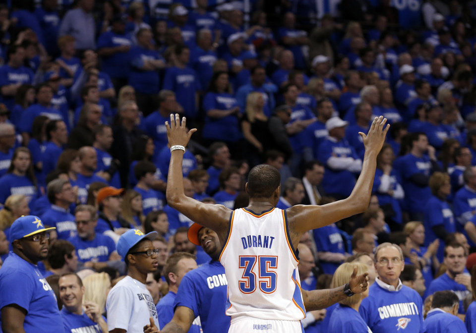 Photo - Oklahoma City's Kevin Durant (35) tells tries to quiet the crowd during a Thunder free throw  Game 1 in the second round of the NBA playoffs between the Oklahoma City Thunder and the Memphis Grizzlies at Chesapeake Energy Arena in Oklahoma City, Sunday, May 5, 2013. Photo by Sarah Phipps, The Oklahoman