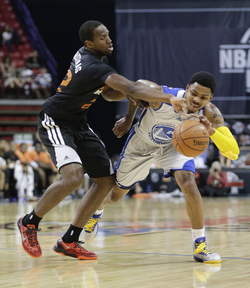 Photo - Phoenix Suns' Dionte Christmas, left, strips the ball from Golden State Warriors guard Kent Bazemore in the first quarter of the NBA Summer League championship game, Monday, July 22, 2013, in Las Vegas. (AP Photo/Julie Jacobson)