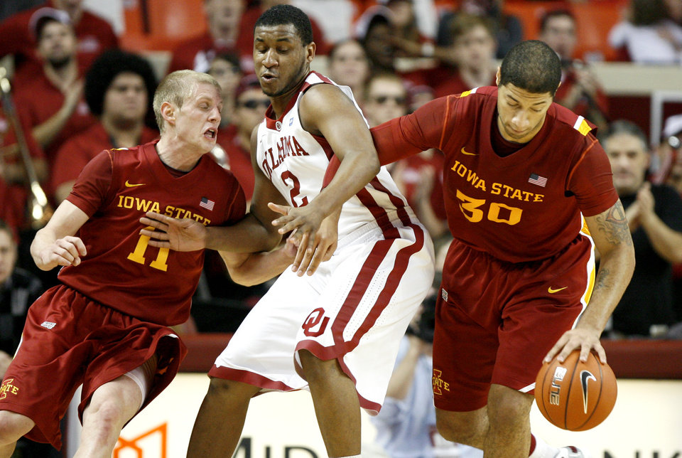 Oklahoma\'s Steven Pledger (2) gets caught between Iowa State\'s Scott Christopherson (11) and Royce White (30) during an NCAA basketball game between the University of Oklahoma Sooners (OU) and the Iowa State Cyclones (ISU) at the Lloyd Noble Center in Norman, Saturday, Feb. 4, 2012. Photo by Bryan Terry, The Oklahoman