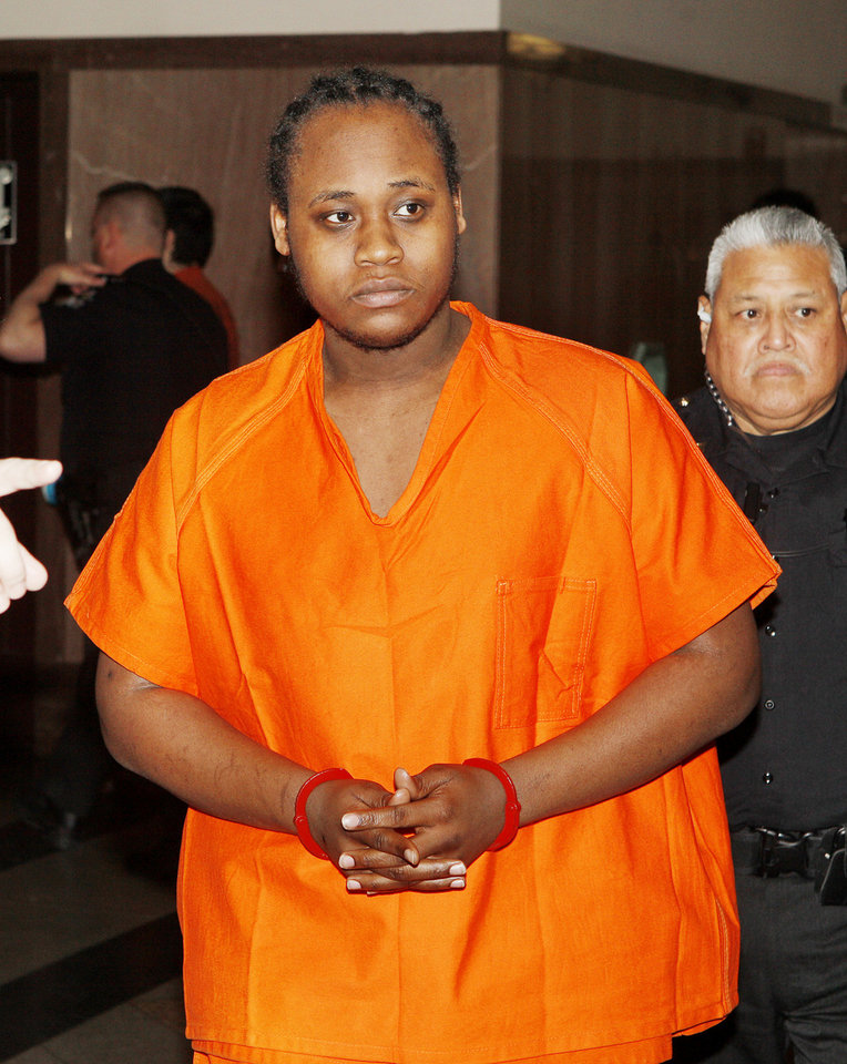 Photo - LaQuan Ashley is led to the courtroom on Wednesday.