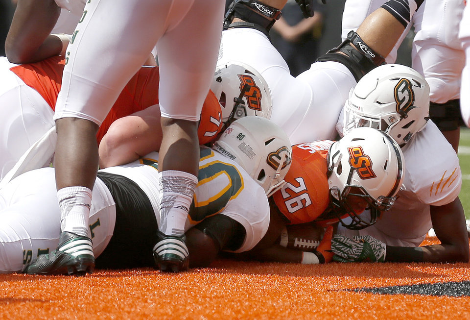 Photo - Oklahoma State's Barry J. Sanders (26) scores a touchdown in the first quarter during the college football game between the Oklahoma State Cowboys (OSU) and the Southeastern Louisiana Lions at Boone Pickens Stadium in Stillwater, Okla., Saturday, Sept. 12, 2015. Photo by Sarah Phipps, The Oklahoman