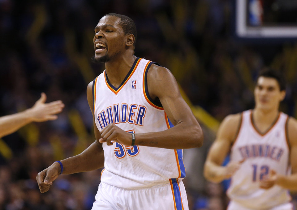 Photo - Oklahoma City's Kevin Durant reacts during an NBA basketball game between the Oklahoma City Thunder and the Golden State Warriors at Chesapeake Energy Arena in Oklahoma City, Friday, Jan. 17, 2014. Photo by Bryan Terry, The Oklahoman