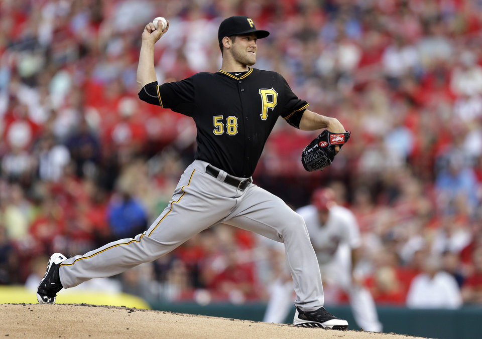 Photo - Pittsburgh Pirates starting pitcher Brandon Cumpton throws during the first inning of a baseball game against the St. Louis Cardinals Wednesday, July 9, 2014, in St. Louis. (AP Photo/Jeff Roberson)