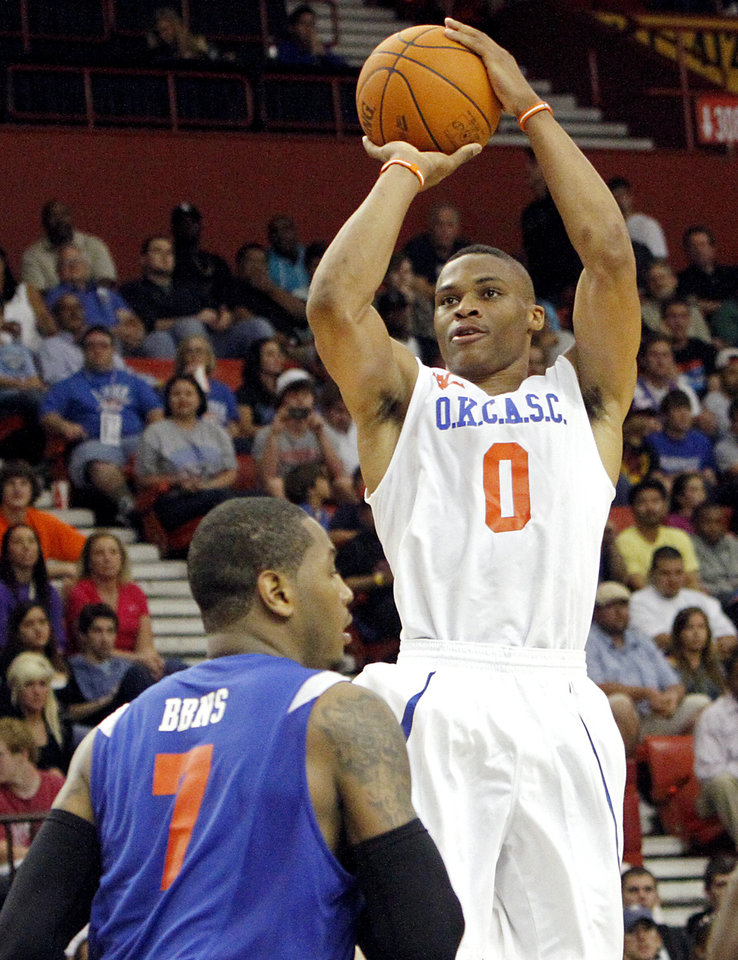 Photo - Russell Westbrook puts up a shot in front of Carmelo Anthony during the US Fleet Tracking Basketball Invitational at the Cox Convention Center in Oklahoma City Sunday, Oct. 23, 2011. The White Team defeated the Blue Team 176-171. Photo by John Clanton, The Oklahoman