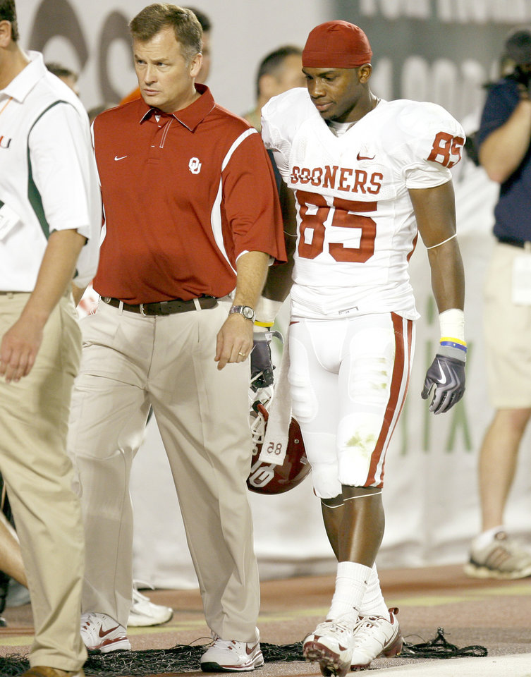 Photo - OU's Ryan Broyles leaves the field in the first half of the college football game between the University of Oklahoma (OU) Sooners and the University of Miami (UM) Hurricanes at Land Shark Stadium in Miami Gardens, Florida, Saturday, October 3, 2009. Photo by Bryan Terry, The Oklahoman