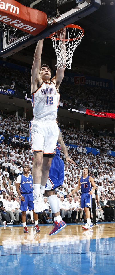 Photo - Steven Adams (12) gets a wide open dunk during Game 5 of the Western Conference semifinals in the NBA playoffs between the Oklahoma City Thunder and the Los Angeles Clippers at Chesapeake Energy Arena in Oklahoma City, Tuesday, May 13, 2014. Photo by Sarah Phipps, The Oklahoman