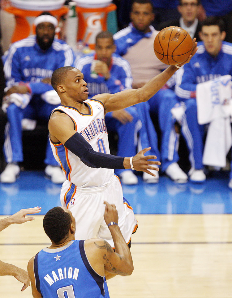 Oklahoma City\'s Russell Westbrook (0) takes the ball to the hoop past Shawn Marion (0) of Dallas in the first half during game 3 of the Western Conference Finals of the NBA basketball playoffs between the Dallas Mavericks and the Oklahoma City Thunder at the OKC Arena in downtown Oklahoma City, Saturday, May 21, 2011. Photo by Nate Billings, The Oklahoman