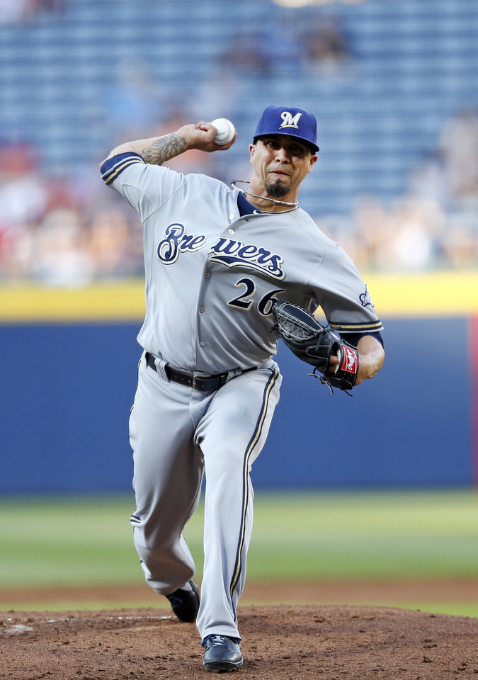 Photo - Milwaukee Brewers starting pitcher Kyle Lohse (26) works in the first inning of a baseball game against Atlanta Braves Wednesday, May 21, 2014 in Atlanta. Milwaukee won 6-1. (AP Photo/John Bazemore)