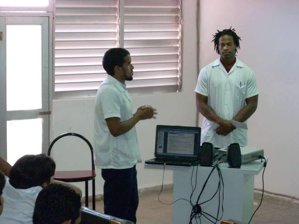 Photo - Former OU linebacker Pasha Jackson, right, gave up the dream of playing in the NFL to study medicine at the Latin American School of Medicine in Havana, Cuba. - Photo Provided  ORG XMIT: 0906212205231652