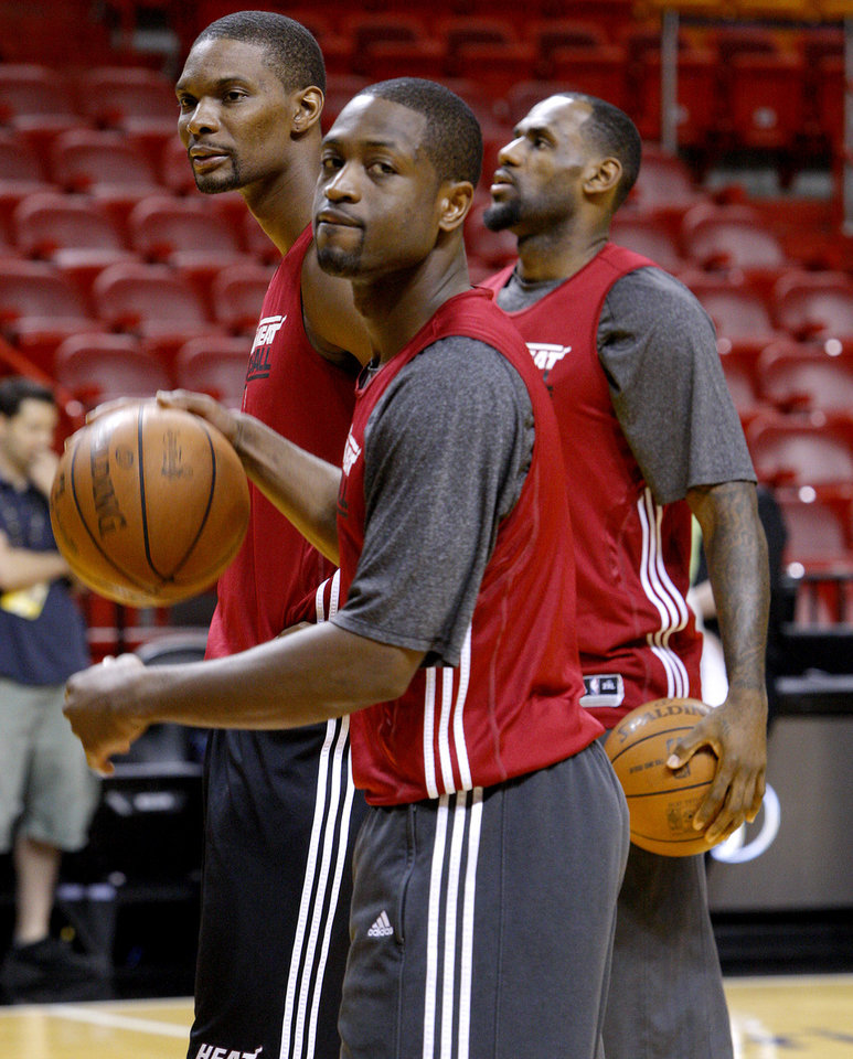 Miami's Dwyane Wade, foreground, Chris Bosh, left, and LeBron James stand on the court during a practice before Game 4 of the NBA Finals between the Oklahoma City Thunder and the Miami Heat at American Airlines Arena, Monday, June 18, 2012. Photo by Bryan Terry, The Oklahoman