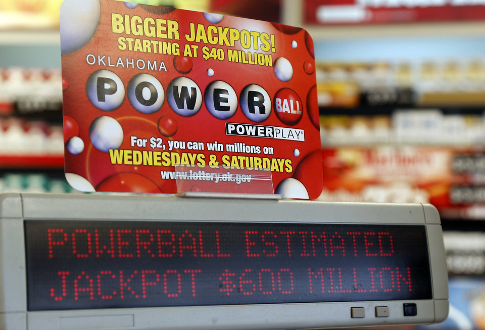 Photo - A sign at a store advertises the Powerball Lottery in Oklahoma City, Friday, May 17, 2013. Powerball officials say the jackpot has climbed to an estimated $600 million, making it the largest prize in the game's history and the world's second largest lottery prize. (AP Photo/Sue Ogrocki)