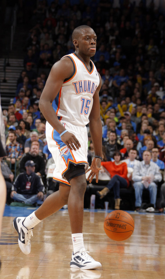 Oklahoma City Thunder\'s Reggie Jackson (15) dribbles up court during the the NBA basketball game between the Oklahoma City Thunder and the San Antonio Spurs at the Chesapeake Energy Arena in Oklahoma City, Sunday, Jan. 8, 2012. Photo by Sarah Phipps, The Oklahoman