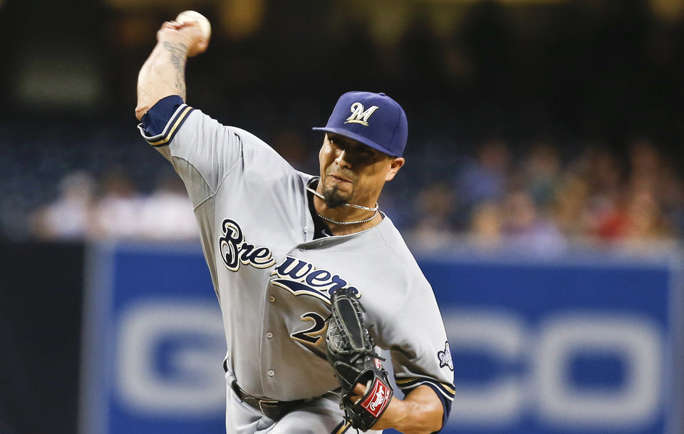 Photo - Milwaukee Brewers starting pitcher Kyle Lohse works against the San Diego Padres in the first inning of a baseball game Monday, Aug. 25, 2014, in San Diego.  (AP Photo/Lenny Ignelzi)