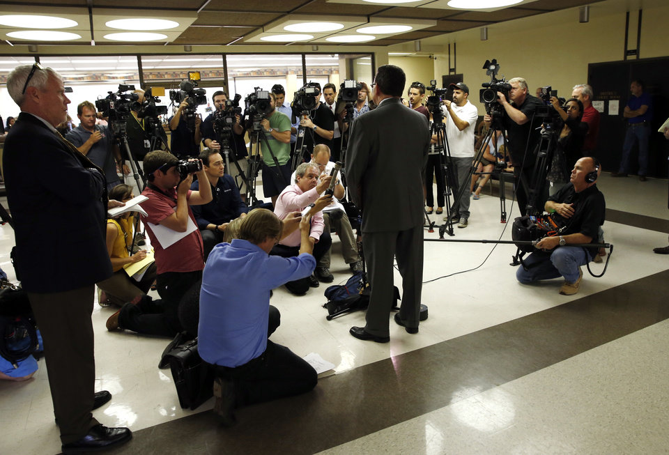 Photo - CHRISTOPHER LANE MURDER / JASON HICKS: District Attorney Jason M. Hicks answers reporter's question after three teenage suspects were arraigned in the shooting death of Christopher Lane on Tuesday, Aug. 20, 2013 in Duncan, Okla.  Photo by Steve Sisney, The Oklahoman