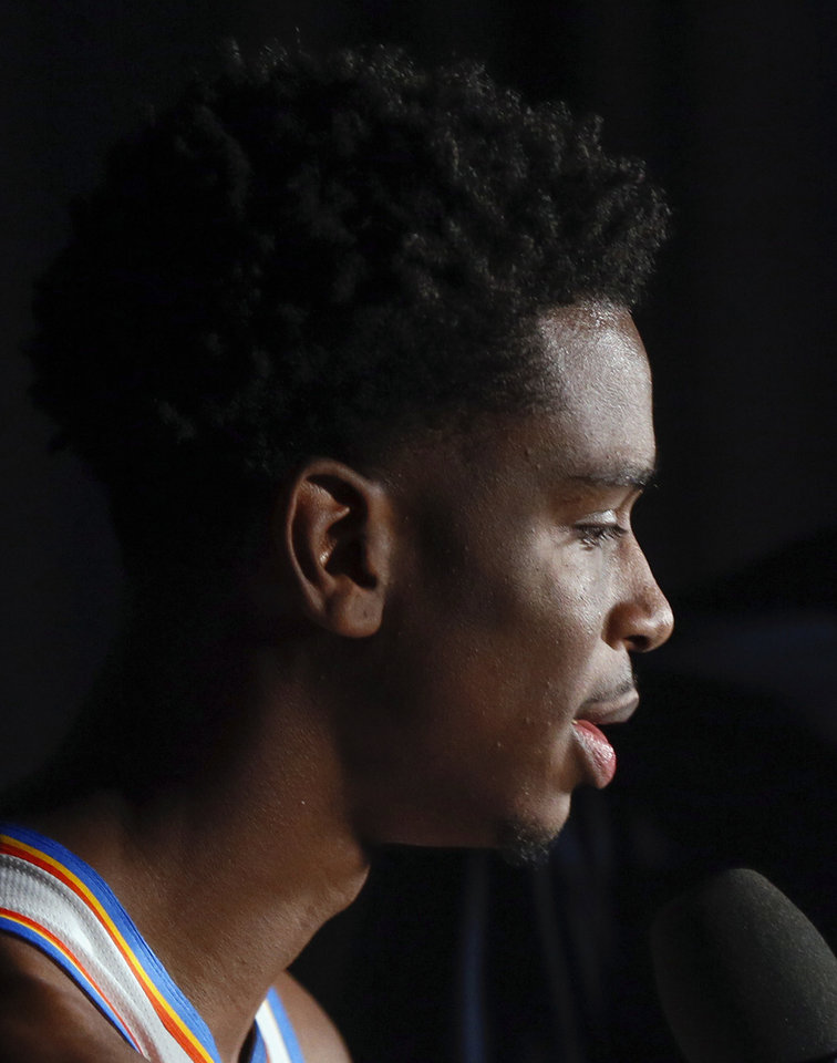 Photo - Oklahoma City's Shai Gilgeous-Alexander gives an interview during media day for the Oklahoma City Thunder NBA basketball team at Chesapeake Energy Arena in Oklahoma City, Monday, Sept. 30, 2019. [Nate Billings/The Oklahoman]