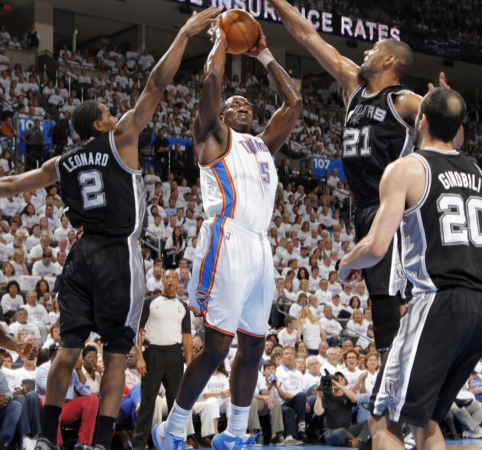 San Antonio's Kawhi Leonard (2) and San Antonio's Tim Duncan (21) defend on Oklahoma City's Kendrick Perkins (5) during Game 6 of the Western Conference Finals between the Oklahoma City Thunder and the San Antonio Spurs in the NBA playoffs at the Chesapeake Energy Arena in Oklahoma City, Wednesday, June 6, 2012. Photo by Chris Landsberger, The Oklahoman