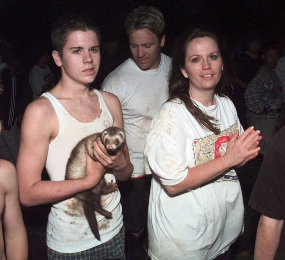 "May 3, 1999 Oklahoma City Tornado:  Tornado victims: Jake Waddle and his family survived the destruction of their home at 1013 S. W. 128th by crouching in their hallway.  Jake's mother Shelly is at right.  The ferrett ""Sam"" survived in his cage through the cage was crushed.  Photo by Steve Sisney"