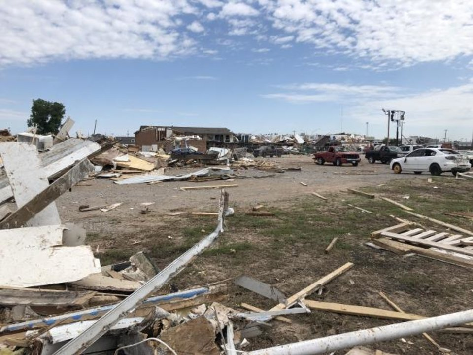 Photo -  Tornado damage near the Skyview Mobile Home Park in El Reno on Friday. Federal aid should be available in the coming weeks after damage assessments are finished. [KAYLA BRANCH/THE OKLAHOMAN]