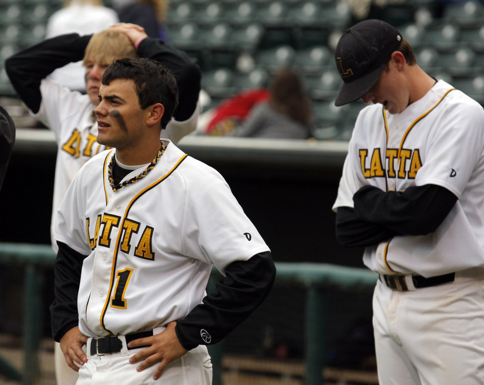 Photo - Latta's Brandon Mills reacts to their loss to Dale at the Class A Fall baseball state championships at the Chickasaw Bricktown Ballpark in Oklahoma City,  Saturday, Oct. 6, 2012. Photo by Sarah Phipps, The Oklahoman