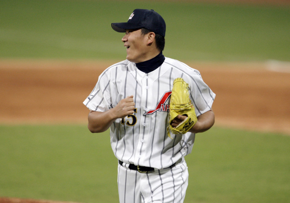 Photo - FILE - In this Aug. 20, 2008, file photo, Japan's pitcher Masahiro Tanaka reactas after watching second baseman Masahiro i Araki knock down what could have been a base hit by the USA's Taylor Teagarden for the third out in the sixth inning in their baseball game at the Beijing 2008 Olympics in Beijing. The New York Yankees and Tanaka agreed on Wednesday, Jan. 22, 2014, to a $155 million, seven-year contract. In addition to the deal with the pitcher, the Yankees must pay a $20 million fee to the Japanese team of the 25-year-old right-hander, the Rakuten Golden Eagles. (AP Photo/Kathy Willens, File)