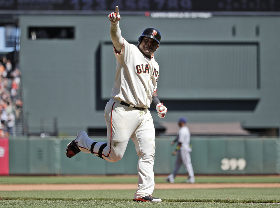 Photo - San Francisco Giants' Pablo Sandoval celebrates as he rounds the bases following his two-run home run against the Milwaukee Brewers during the fifth inning of a baseball game on Sunday, Aug. 31, 2014, in San Francisco. (AP Photo/Marcio Jose Sanchez)