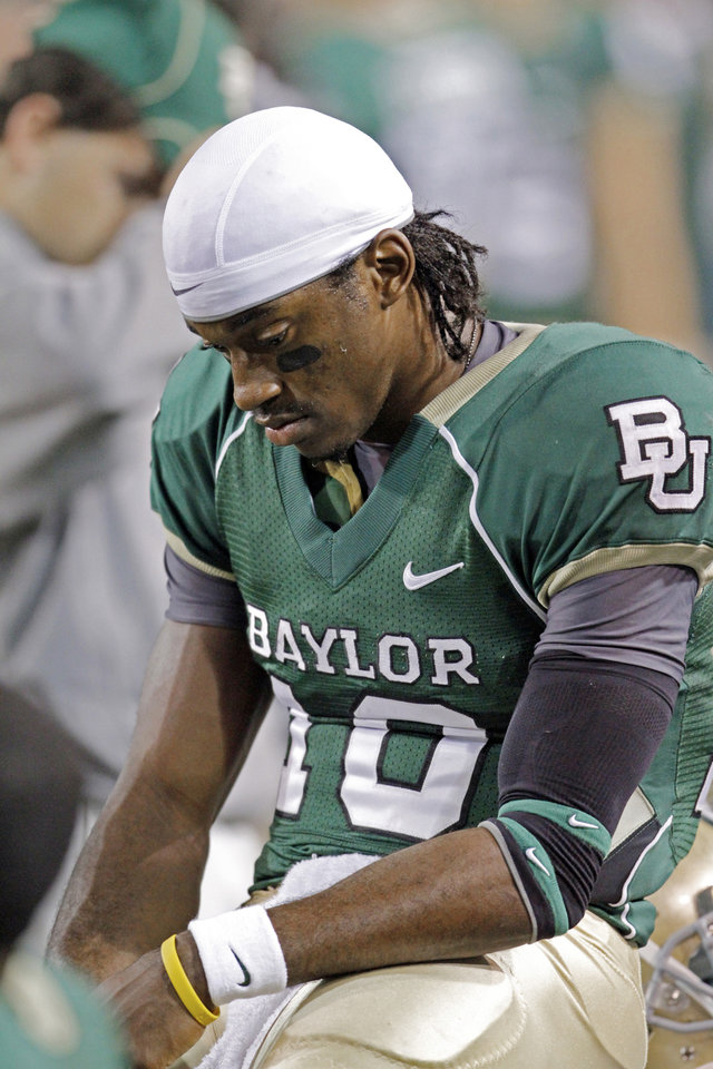 Photo - Baylor quarterback Robert Griffin III sits on the sidelines during the final minutes of the second half of the college football game between the University of Oklahoma Sooners (OU) and the Baylor Bears (BU) at Floyd Casey Stadium on Saturday, November 20, 2010, in Waco, Texas.   Photo by Steve Sisney, The Oklahoman