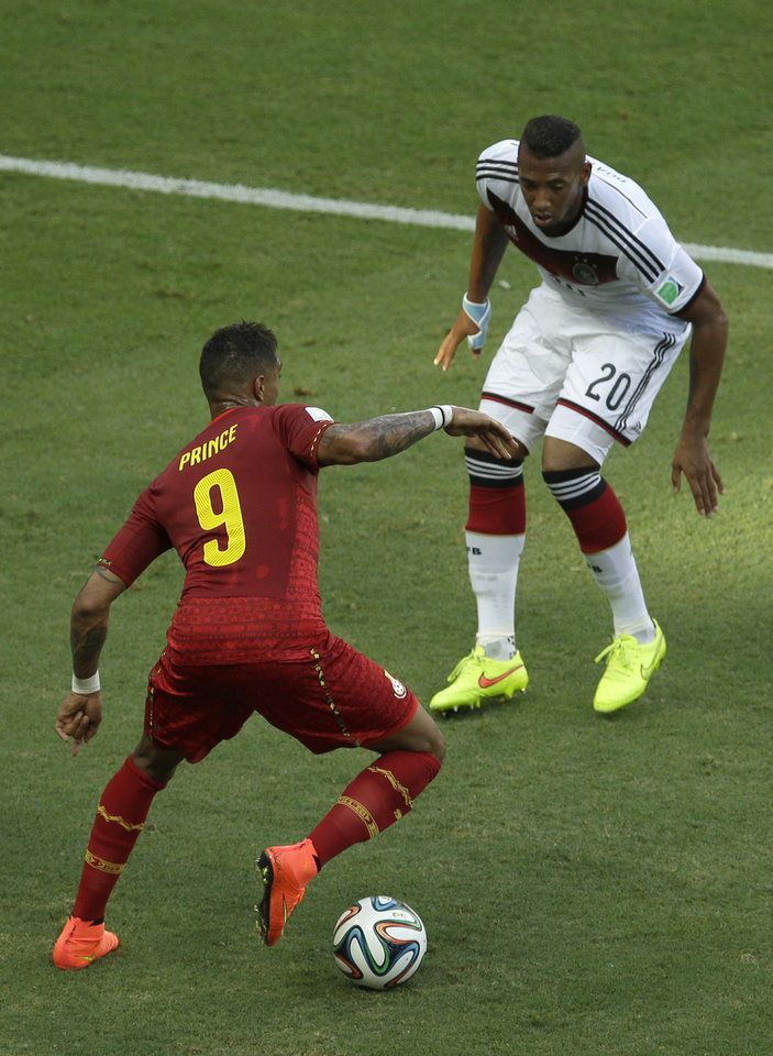 Photo - Germany's Jerome Boateng, righ, and his half-borther Ghana's Kevin-Prince Boateng challenge for the ball during the group G World Cup soccer match between Germany and Ghana at the Arena Castelao in Fortaleza, Brazil, Saturday, June 21, 2014. (AP Photo/Themba Hadebe)