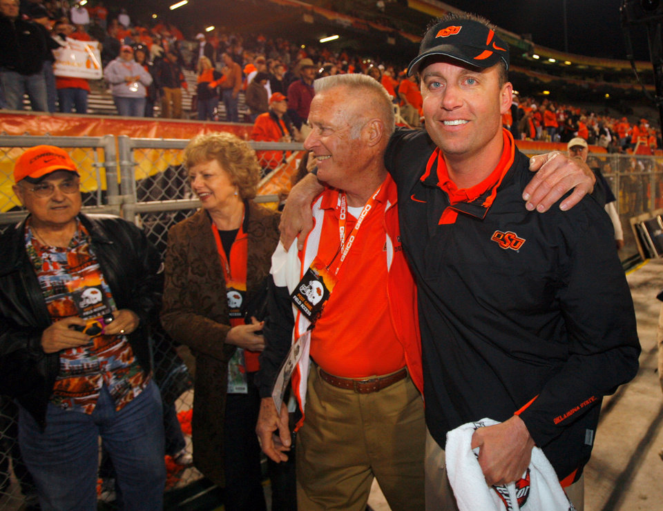 Photo - Oklahoma State coach Mike Gundy celebrates after the Cowboys' win over Indiana in the Insight Bowl college football game between Oklahoma State University (OSU) and the Indiana University Hoosiers (IU) at Sun Devil Stadium on Monday, Dec. 31, 2007, in Tempe, Ariz. 