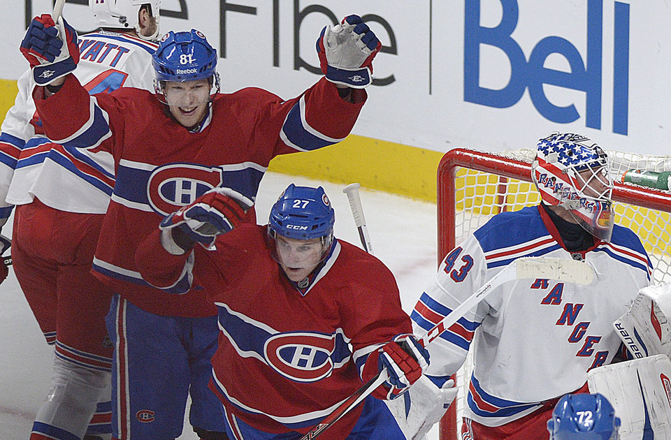 Photo - Montreal Canadiens' Alex Galchenyuk (27) and Lars Eller (81) celebrate Galchenyuk's goal against New York Rangers goaltender Martin Biron, right, during the second period of an NHL hockey game in Montreal, Saturday, Feb. 23, 2013. (AP Photo/The Canadian Press, Graham Hughes)
