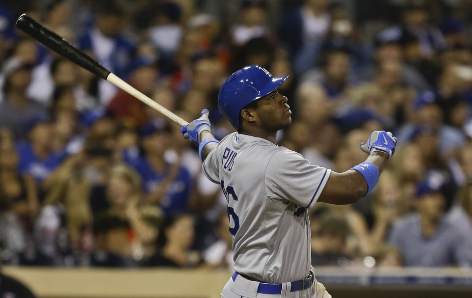 Photo - Los Angeles Dodgers' Yasiel Puig admires the flight of his two-run homer to center field against the San Diego Padres in the seventh inning of a baseball game Saturday, Sept. 21, 2013, in San Diego. (AP Photo/Lenny Ignelzi)