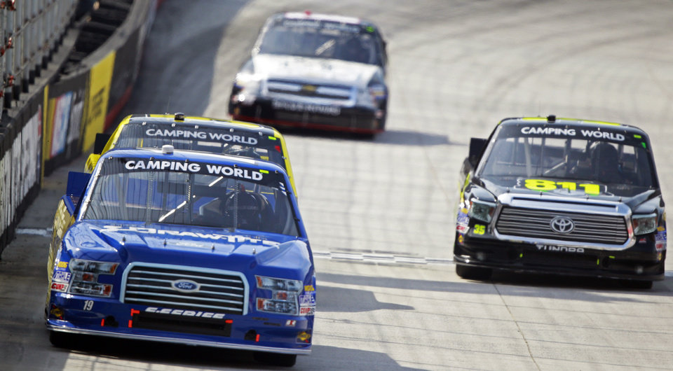 Photo - Driver Brad Keselowski (19) leads as he comes down the front straight during the NASCAR UNOH 200 Truck Series auto race on Thursday, Aug. 21, 2014, in Bristol, Tenn. (AP Photo/Wade Payne)