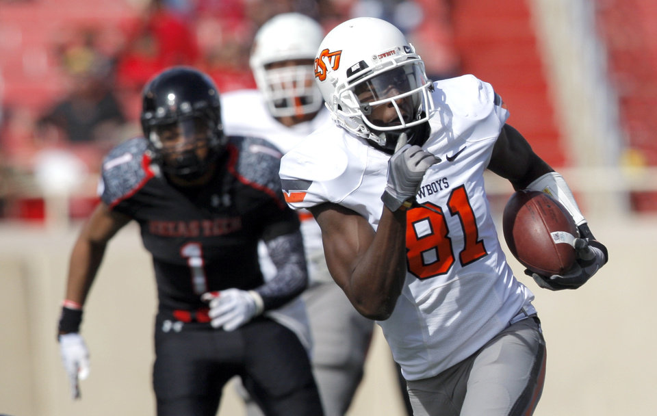 Photo - Oklahoma State's Justin Blackmon (81) runs after a catch during a college football game between Texas Tech University (TTU) and Oklahoma State University (OSU) at Jones AT&T Stadium in Lubbock, Texas, Saturday, Nov. 12, 2011.  Photo by Sarah Phipps, The Oklahoman  ORG XMIT: KOD
