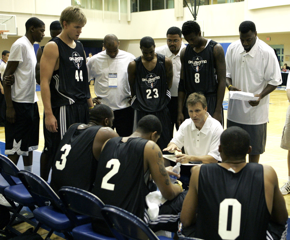 Photo - OKC NBA, FORMER SEATTLE SUPERSONICS, SONICS BASKETBALL TEAM: Oklahoma City summer league coach Scott Brooks, seated center right, gives instructions to his players during a timeout in an NBA summer league basketball game against the Indiana Pacers in Orlando, Fla., Monday, July 7, 2008. (AP Photo/John Raoux) ORG XMIT: FLJR106