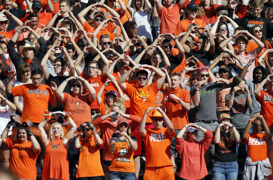 Photo - OSU fans during a college football game between the Oklahoma State University Cowboys (OSU) and the Texas Longhorns (UT) at Boone Pickens Stadium in Stillwater, Okla., Saturday, Oct. 1, 2016. Photo by Nate Billings, The Oklahoman
