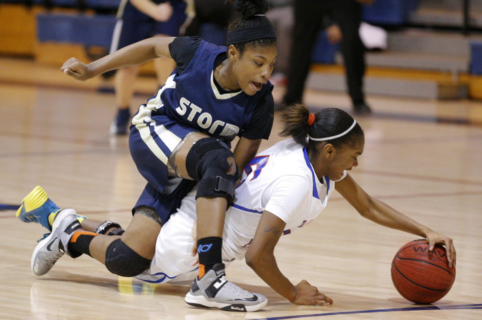 Photo - The Storm's Pae Pae Hawkins, left, goes for the ball beside Millwood's Deztinee Gooden during Tuesday's game at Millwood.  Photo by Bryan Terry, The Oklahoman