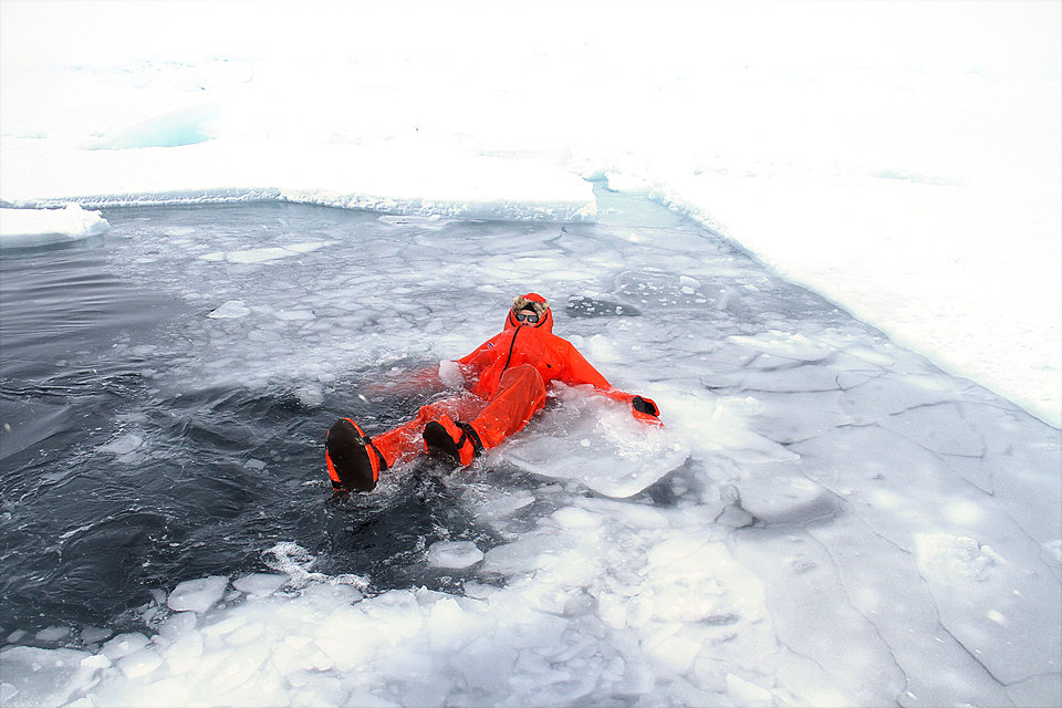 Photo - Doug Beall takes a dip in 28-degree salt water to try out a dry suit.