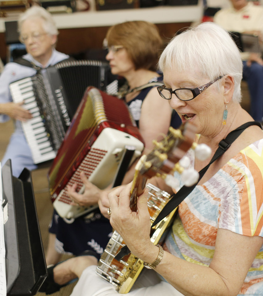 Photo -  Louis Roth, Anne Lopez and Barbara Duer play at the monthly meeting of the Oklahoma City Accordion Club at Messiah Lutheran Church. Photo by Doug Hoke, The Oklahoman   DOUG HOKE