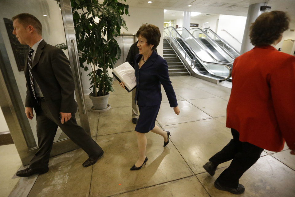 Photo -   Sen. Susan M. Collins, R-Maine, ranking Republican on the Homeland Security and Governmental Affairs Committee, arrives for a closed briefing on Capitol Hill in Washington, Wednesday, Nov. 14, 2012. Earlier, Collins said it was