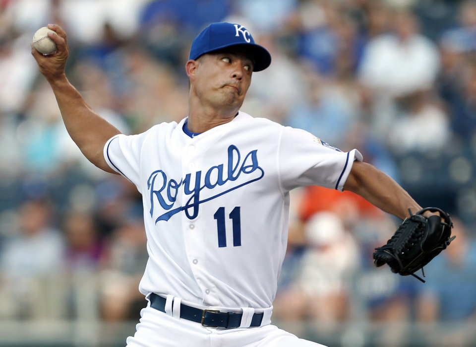Kansas City Royals starting pitcher Jeremy Guthrie (11) delivers to a Chicago White Sox batter during the first inning of a baseball game at Kauffman Stadium in Kansas City, Mo., Friday, June 21, 2013. (AP Photo/Orlin Wagner)