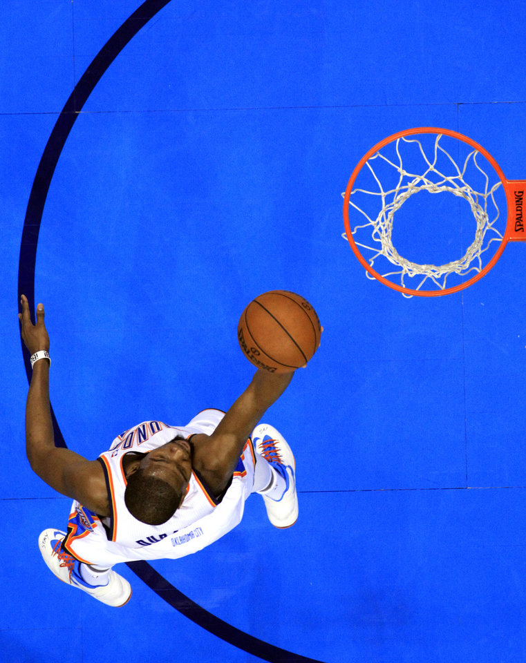 Photo - Oklahoma City's Kevin Durant (35) shoots a lay up during NBA basketball game between the Oklahoma City Thunder and the New York Knicks at the Chesapeake Energy Arena, Sunday, April 7, 2010, in Oklahoma City. Photo by Sarah Phipps, The Oklahoman