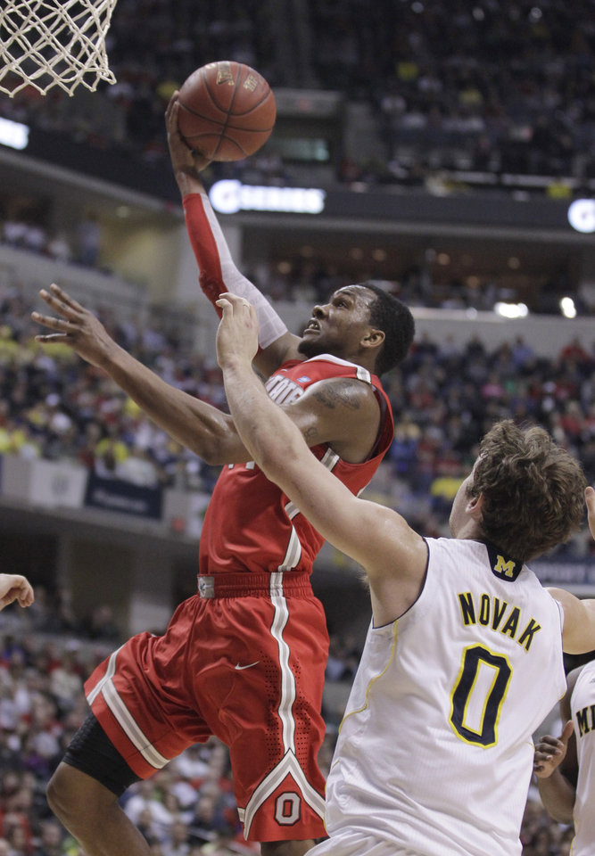 Photo -   Ohio State guard William Buford goes up for a basket against Michigan guard Zack Novak (0) in the first half of an NCAA college basketball game in the semifinals of the Big Ten Conference tournament in Indianapolis, Saturday, March 10, 2012. (AP Photo/Michael Conroy)