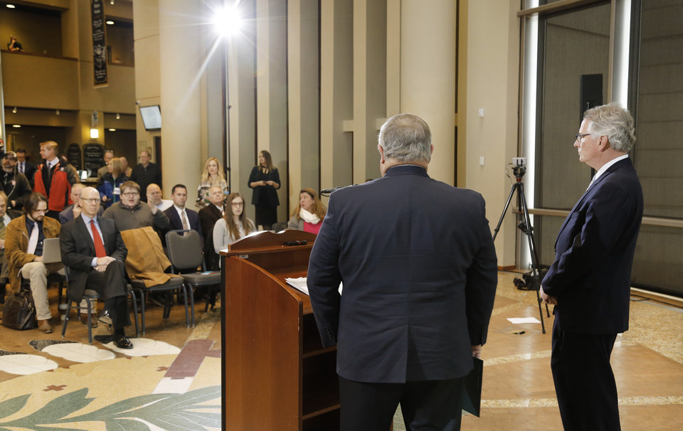Photo - David Rainbolt, an Oklahoma banker, right, and attorney Glenn Coffee, former state senator and Oklahoma Secretary of State,  unveil reform and revenue measures at a news conference in the atrium of the Oklahoma History Center.  Frustrated by a legislative budget impasse that has stalled state progress, a statewide coalition of Oklahoma business and civic leaders (STEPUPOK) proposed a comprehensive solution Thursday, Jan. 11, 2018,  that would increase state revenues, fund $5,000 teacher pay raises and alter the structure of state and county government.  The proposal calls for raising gross production, motor fuel and cigarette taxes, while eliminating certain individual income tax deductions and loopholes.  The business leaders said their willingness to support the proposed revenue hikes is directly tied to lawmakers' willingness to vote for $5,000 teacher pay increases and embrace 10 reforms to the structure of state and county government, many of which also would require the public's approval through votes on constitutional amendments.  Photo by Jim Beckel, The Oklahoman