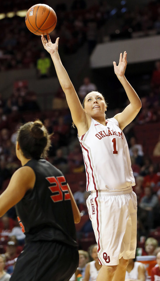 Photo - Oklahoma's Nicole Kornet (1) shoots over Cal State Northridge's Jasmine Johnson (35) in the second half during a women's college basketball game between the University of Oklahoma (OU) and Cal State Northridge at the Lloyd Noble Center in Norman, Okla., Saturday, Dec. 29, 2012. OU won, 79-57.  Photo by Nate Billings, The Oklahoman