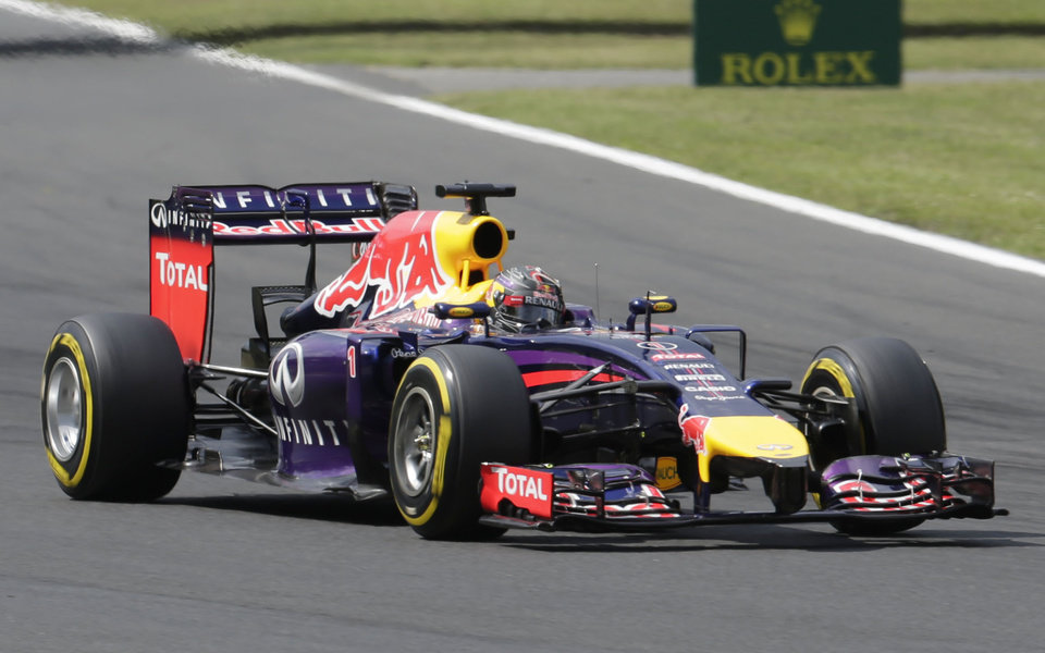 Photo - Red Bull driver Sebastian Vettel of Germany steers his car during the qualifying at the Hungarian Formula One Grand Prix in Budapest, Hungary, Saturday, July 26, 2014. The Hungarian Grand Prix will be held on Sunday, July 27, 2014. (AP Photo/Petr David Josek)
