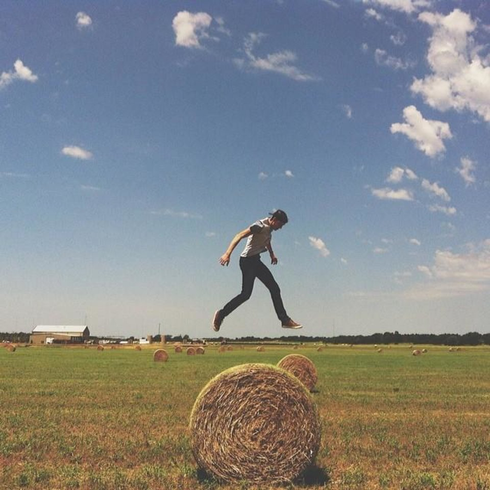 Photo - - Brian Lawes (@brianlawes) - 24 I believe life needs adventure to keep our eyes open to how incredible the world around us is, so I began joining friends at work on their Thursday photo adventures around OKC. This particular photo adventure we were exploring and jumping off hay bales near Jones, OK.  It shows off one of my favorite things about Oklahoma, that in just a span of a few miles you can go from an awesome downtown to a wide open space of country.