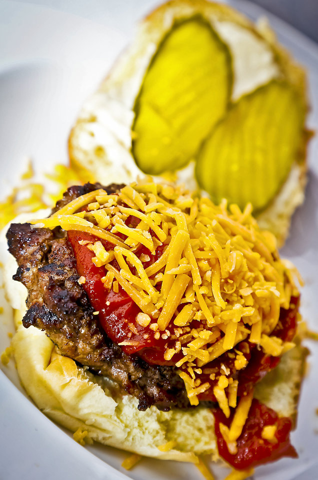 Photo - Theta Burger for a tailgate cookout. Photo by Chris Landsberger, The Oklahoman  CHRIS LANDSBERGER - CHRIS LANDSBERGER